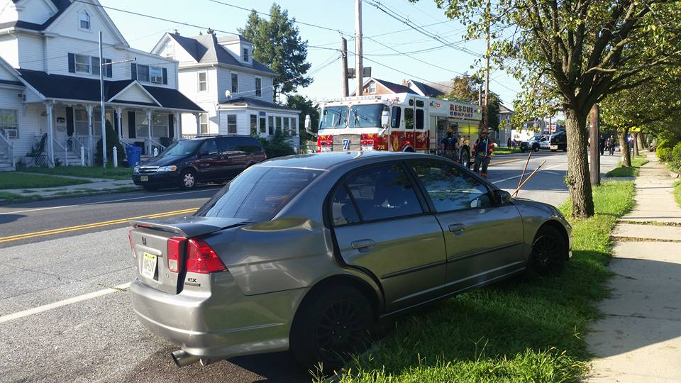 Rescue and BLS handle crash with one vehicle overturned on Broadway
