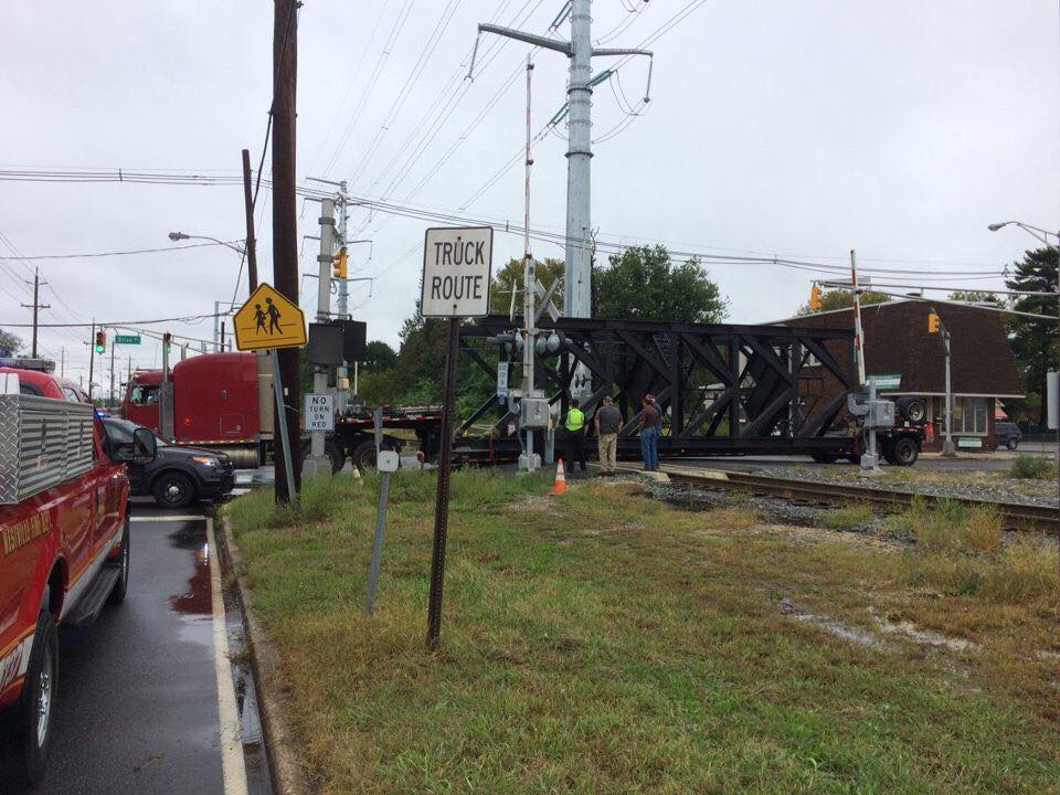 Utility handles tractor trailers stuck on railroad tracks