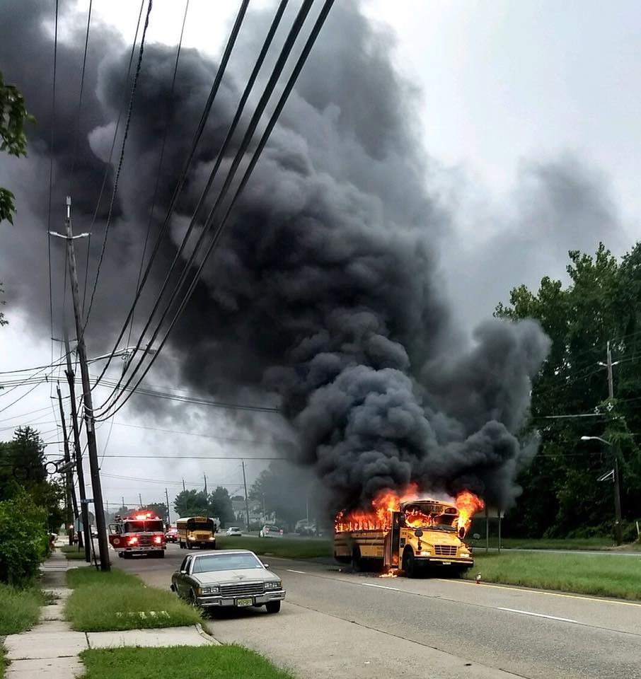 Companies handle fully involved school bus